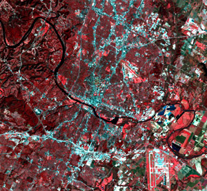 A color infrared composite (bands 432) of a Landsat 7 ETM+ acquisition on Nov. 13, 2002. This subset, from path 27 row 39, is centered on downtown Austin, Texas, and shown at a scale of 1:100,000.